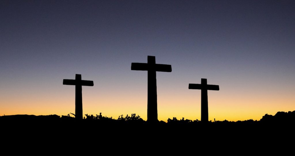 landscape-view-of-3-cross-standing-during-sunset